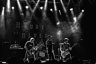 Black Flag (band) - Black Flag (Greg Ginn, Brandon Pertzborn, Mike Vallely, and Tyler Smith) performing at the House of Blues in Anaheim, CA, 2014.