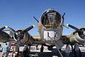 Boeing B-17G-85-DL Flying Fortress Nine-O-Nine Robinson R44 Raven overhead 01 CFatKAM 09Feb2011 (14797313018).jpg