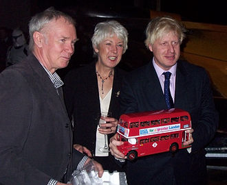 New Routemaster - Boris Johnson with a model of an original AEC Routemaster bearing a political slogan during his 2008 London mayoral campaign