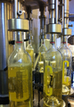 Bottles being filled in a bottling truck.png