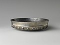 Bowl with bosses and lotus pattern and demotic weight on rim MET DP239400.jpg