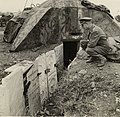 British soldier looking at gravestones from the desecrated Jewish cemetery of Salonica.jpg