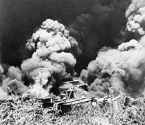 British troops destroy equipment and machinery at the Yenangyaung oilfields in Burma before retreating, 16 April 1942. IND989.jpg