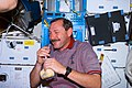 Brown on middeck with drink packet during STS-95.jpg