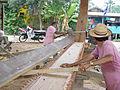 Building the Naga Pelangi - fitting the first plank.jpg