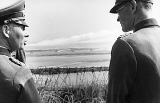 Rommel observes the fall of shot at Riva-Bella, just north of Caen in the area that would become Sword Beach in Normandy. Bundesarchiv Bild 101I-300-1863-29, Riva-Bella, Waffenvorfuhrung Panzerwerfer, Rommel.jpg
