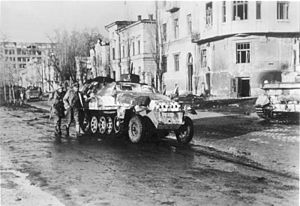 Third Battle of Kharkov - German armored personnel carrier advancing through the Sumskaya street of Kharkov, March 1943