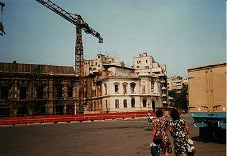 Revolution Square, Bucharest - Buildings on the northern edge of the square under repair from fire damage and bullet holes after the 1989 revolution, July 1990.