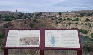 Burra, South Australia - Burra Burra open cut mine pit. Original working buildings in the background