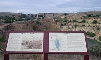 Burra, South Australia - Burra Burra open cut mine pit. Original working buildings in the background