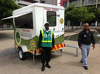 A picture of a Cape Town Central City Improvement District trailer with a guard and security manager.