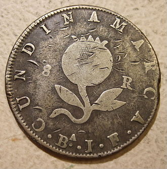 """Currency of Colombia - Reverse: figure of pomegranate, """"8"""" and """"R"""" on either side, with legend """"CUNDINAMARCA"""", Bogotá mint mark """"BA"""", and assayer's initials """"J.F."""""""