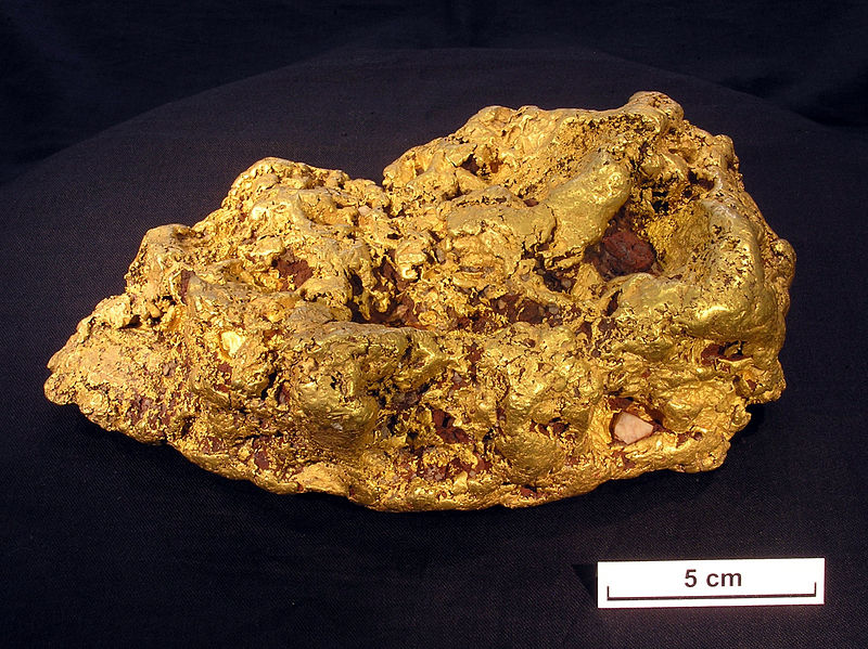 File:CSIRO ScienceImage 10458 An 8 kg nugget from Victoria that was cut in two and had a thin slice.jpg