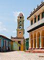 Calle de Trinidad en el casco histórico, al fondo el campanario de la iglesia.jpg