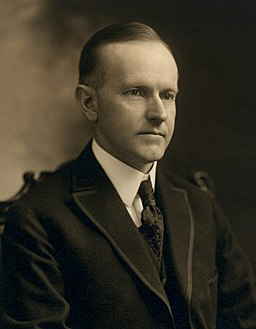 Calvin Coolidge, bw head and shoulders photo portrait seated, 1919