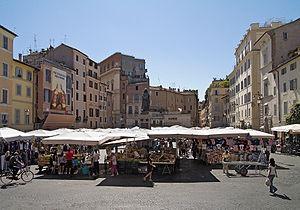 Campo de' Fiori - The daily market with the statue of Giordano Bruno in the background.