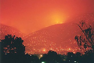 2003 Canberra bushfires - Canberra's suburban hills engulfed in flames during the bushfires.