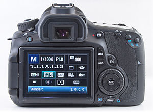 Canon EOS - Rear view of Canon 60D featuring quick control dial to the right of the LCD screen.