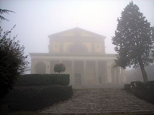 Canoscio - The façade of the sanctuary in the mist.