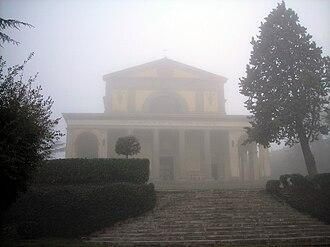 Canoscio - The façade of the sanctuary in the mist.