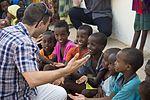 Capt. Michael Silva entertains a group of children.jpg