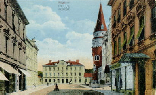 Una vecchia cartolina della stazione ferroviaria e del Celjski dom.