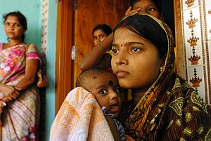 Healthcare in India - A woman and her baby boy are healthy and safe post delivery, after receiving access to healthcare services through an assistance program in Orissa, India.