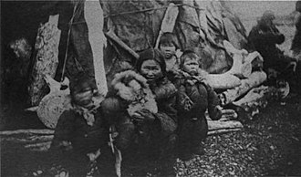 Cape Vankarem - Small children and mother in front of a yaranga at Cape Vankarem in 1881. Picture by Edward William Nelson