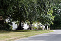Church St and Cock Inn through trees at Henham Essex England.jpg