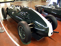 A rear three-quarter picture of a Cooper T51, the first World Championship-winning mid-engined Formula One car.