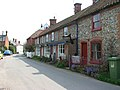 Corpusty - flint and brick cottages - geograph.org.uk - 1257389.jpg