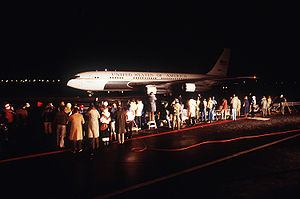 Boeing C-137 Stratoliner - Spectators watch one of two C-137B Stratoliner aircraft returning freed hostages after their release from Iran in 1981