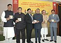 Dayanidhi Maran releasing the CDs containing Software Tools & Fonts of Urdu, Punjabi, Marathi, Malayalam, Oriya, Kannada and Assamese for free distribution, in New Delhi. The Home Minister, Shri Shivraj V. Patil.jpg