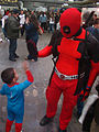 Deadpool high fives little Spider-Man.jpg