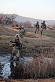 Defense.gov News Photo 110108-M-6340O-155 - U.S. Marines with 1st Platoon Kilo Company 3rd Battalion 5th Marine Regiment cross a canal during a security patrol in Sangin Afghanistan on.jpg