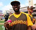 Dexter Fowler poses with a magenta baseball during the T-Mobile -HRDerby. (28542748456).jpg
