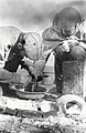 Diamond Jenness treating injuries of Ayalit at Bernard Harbour (38682).jpg