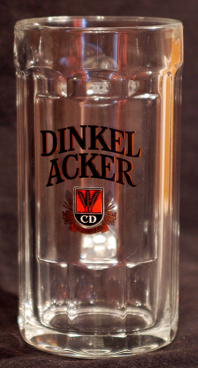 A branded Dinkelacker beer glass.