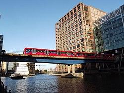 Dockland railway bridge over water.JPG