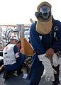Donning the firefighter gear DVIDS107983.jpg