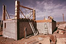 Earthship - Wikipedia on earthen homes plans, quonset hut homes plans, earth berm home plans, straw bale house plans, compressed earth block house plans, earth oven plans, tire houses plans, large rambler house plans, earth home floor plans, rammed tire building, partial earth contact home plans,