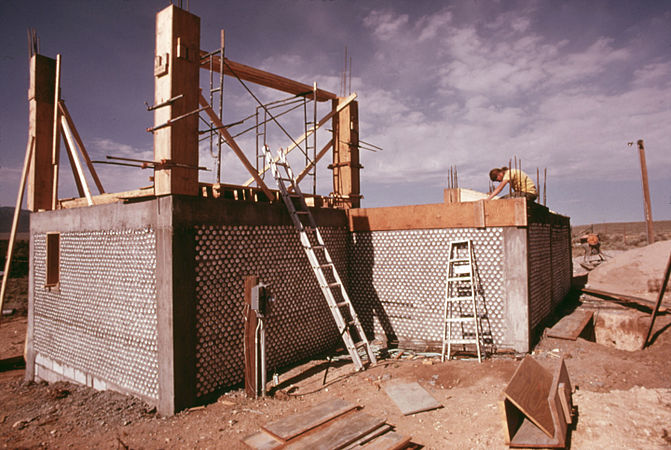 EXTERIOR OF AN EXPERIMENTAL ALL ALUMINUM BEER AND SOFT DRINK CAN HOUSE UNDER CONSTRUCTION NEAR TAOS, NEW MEXICO. THIS... - NARA - 556642.jpg