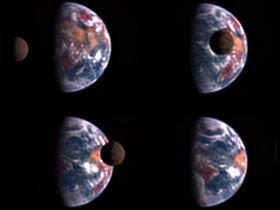 The dark shadowed disk of the Moon moves across the face of the quarter-phase Earth, covering only a small part of the cloud-swirled semicircle.