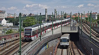 Vienna U-Bahn - Train sets of lines U6 and U4 entering the interchange station Längenfeldgasse
