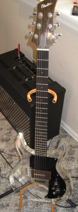Leslie West - Photo of an Electra Plexiglass guitar of the type West used for slide guitar during the 1970s. This guitar was often mistaken for the nearly identical Dan Armstrong from which it was copied
