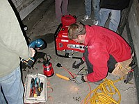 An electrician hooking up a generator to a home's electrical panel.