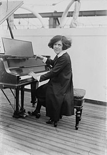 Ethel Leginska sitting at a piano