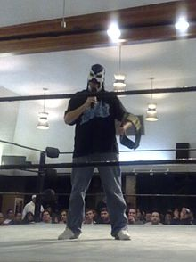 Excalibur holding the PWG World Championship 2009.jpg