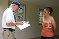 FEMA - 44691 - FEMA Public Assistance worker with resident in Puerto Rico.jpg
