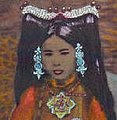 Face detail, Rinchen Dolma Taring (aka Mary Tsarong) with headdress in 1921, hand colored (cropped).jpg